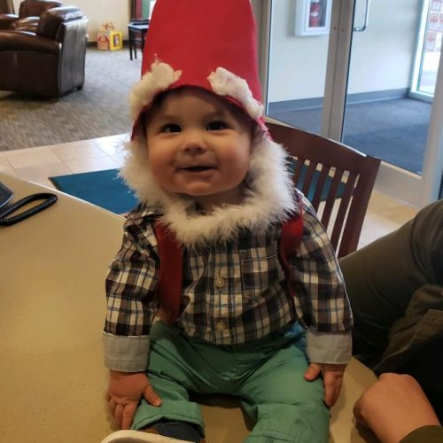 Baby member dressed up on Halloween sitting on a table at White River Credit Union