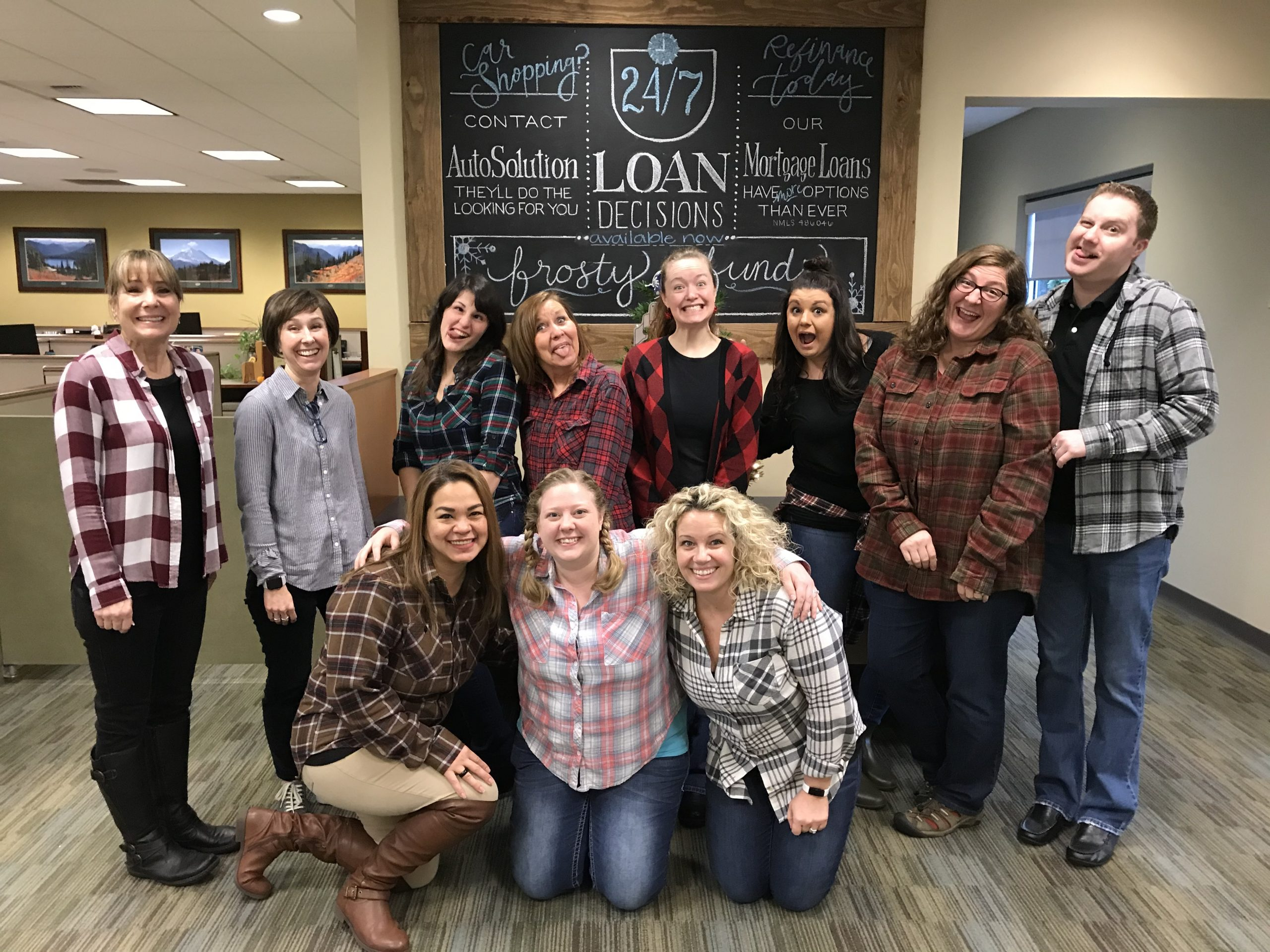 White River CU employees wearing flannels and posing for Flannel Friday