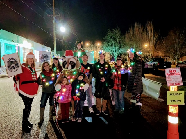 White River Credit Union Employees posing and dressed up at the Enumclaw Christmas Parade