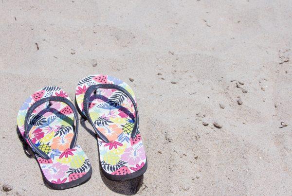 Flip flops on sand