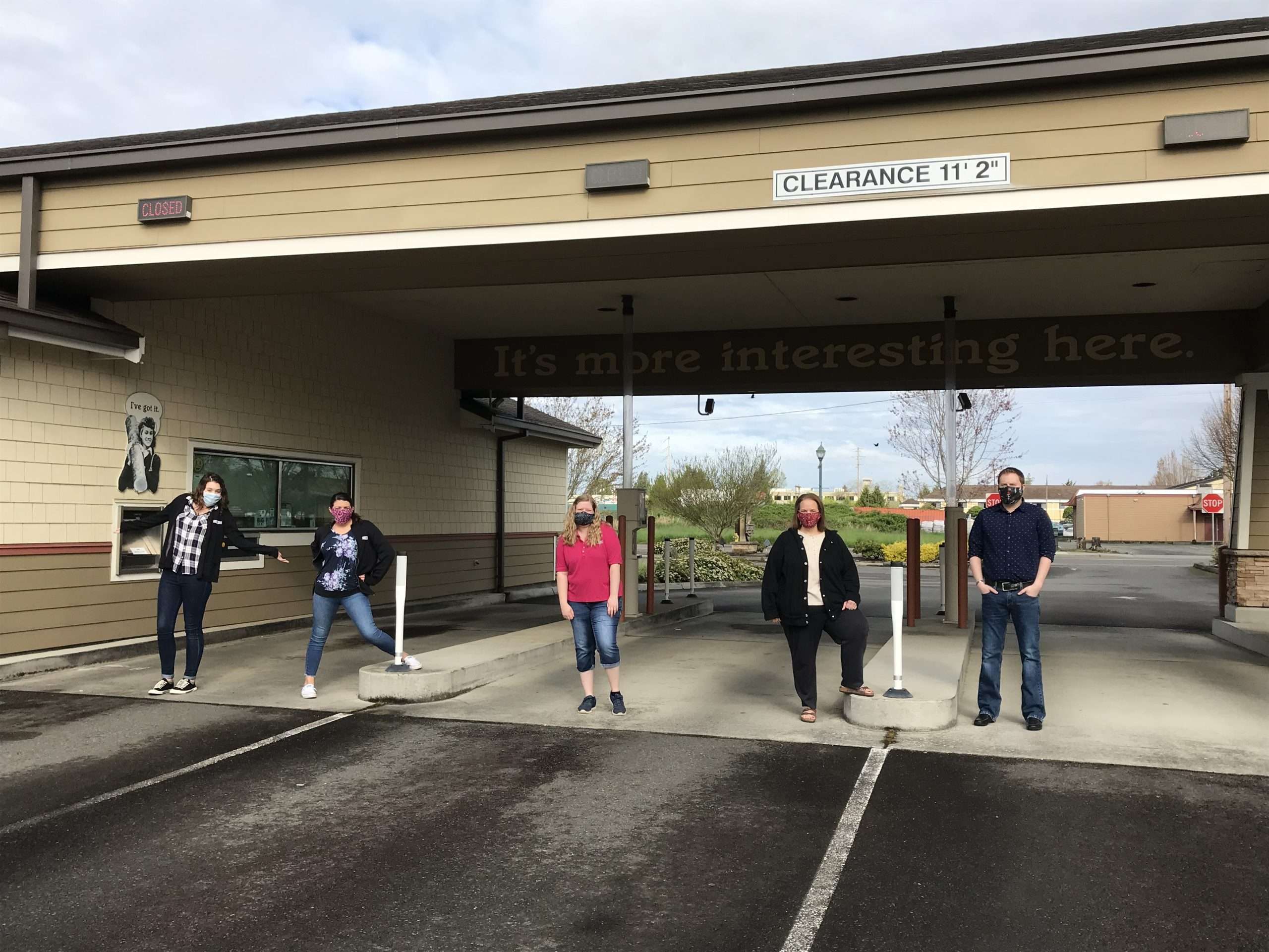 White River CU employees standing outside the drive through wearing masks