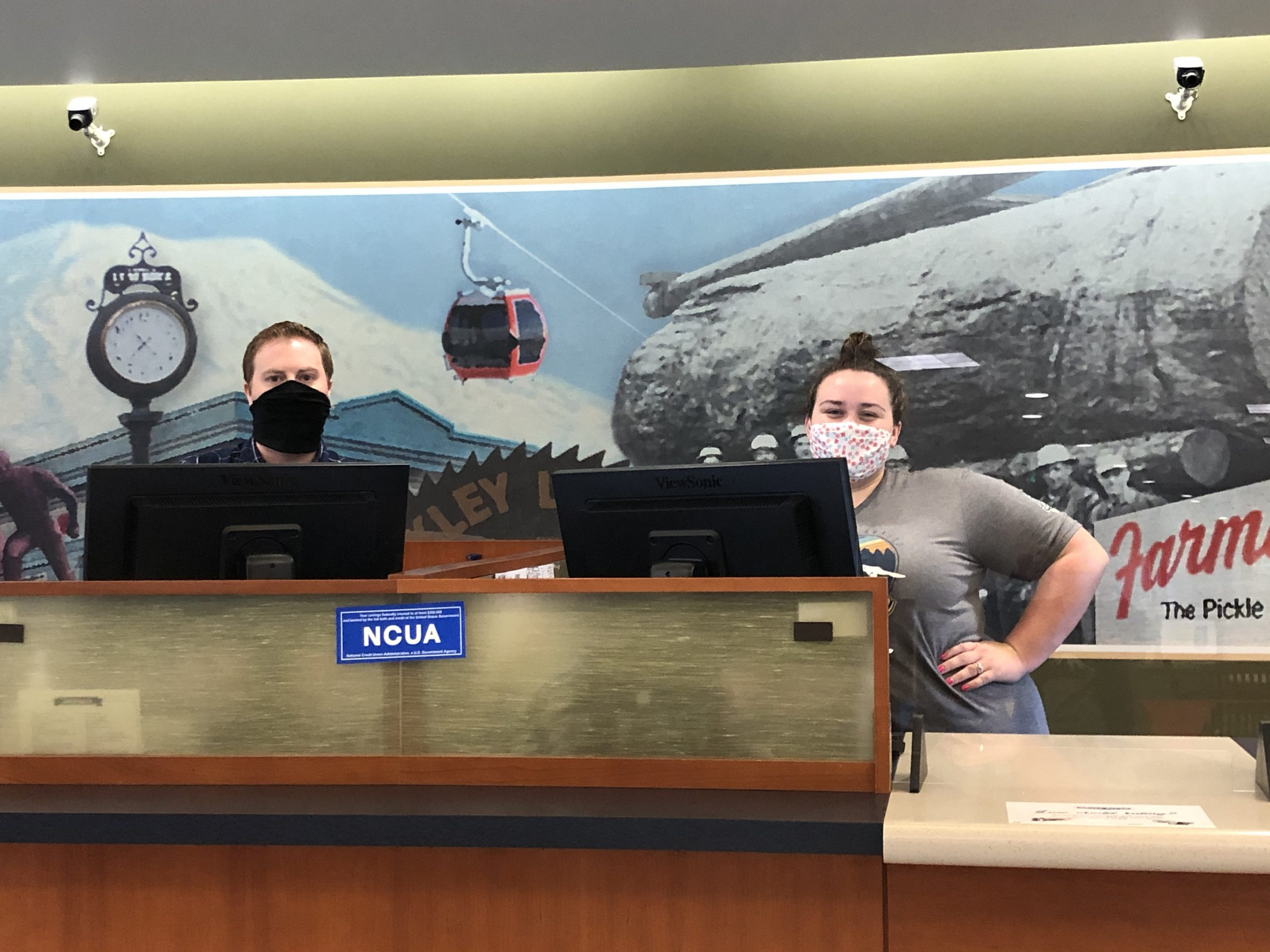 White River Credit Union employees standing behind desk