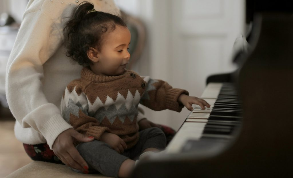 little girl on piano
