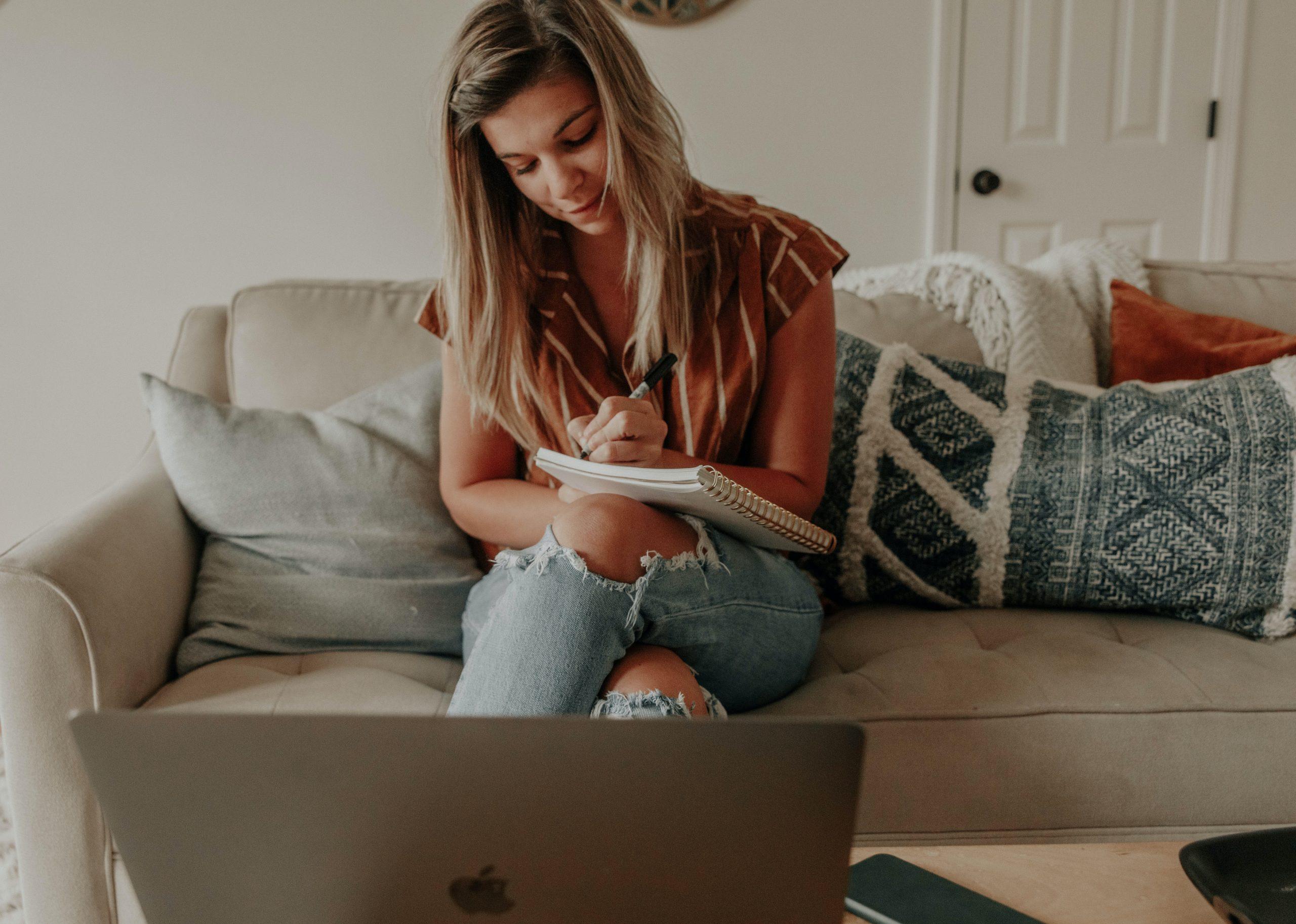 Woman watching WRCU webinar on laptop