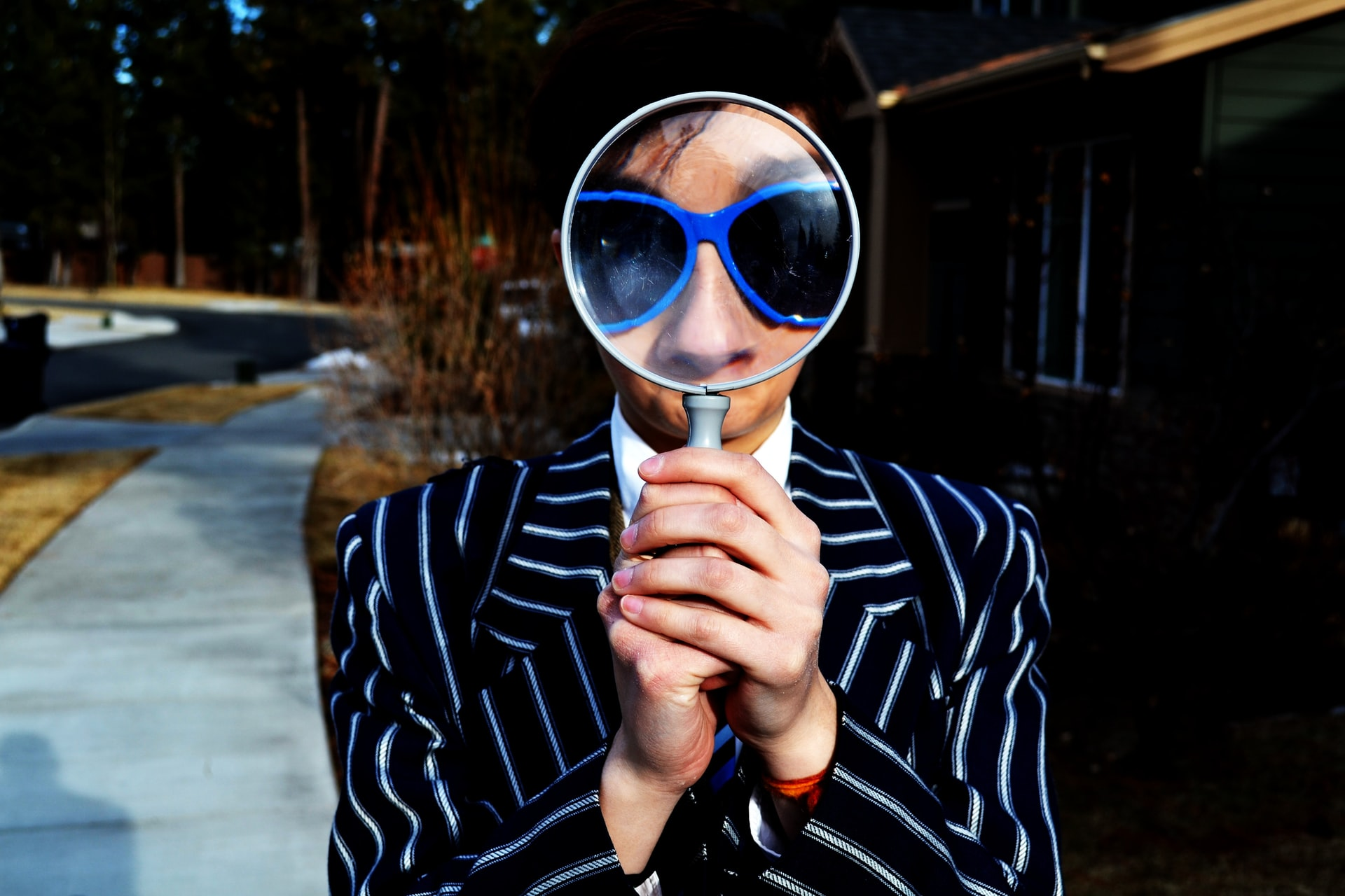 person looking thru magnifying glass