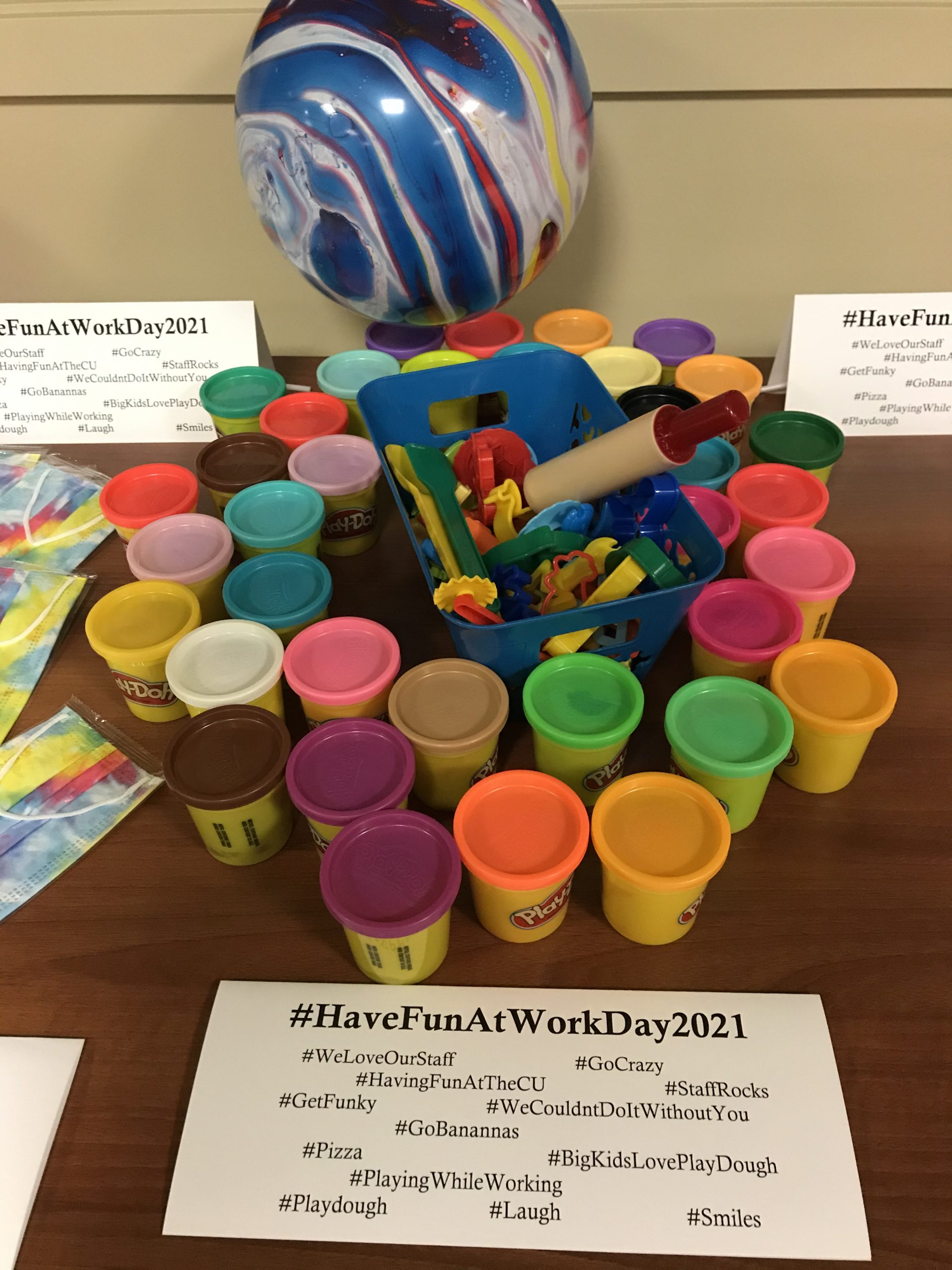 Play-doh, masks, and balloons for have fun at work day