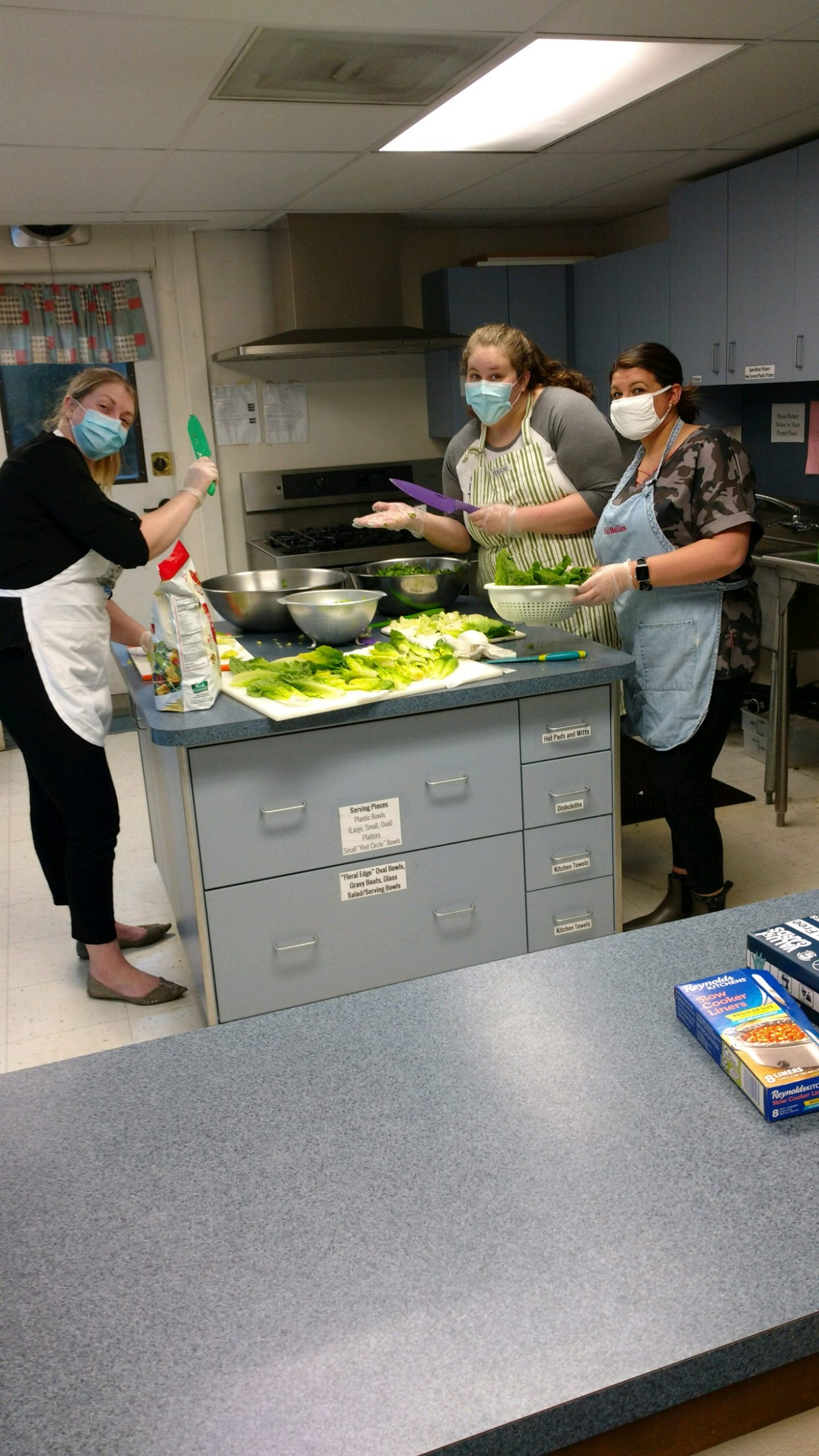 White River Credit Union employees making food
