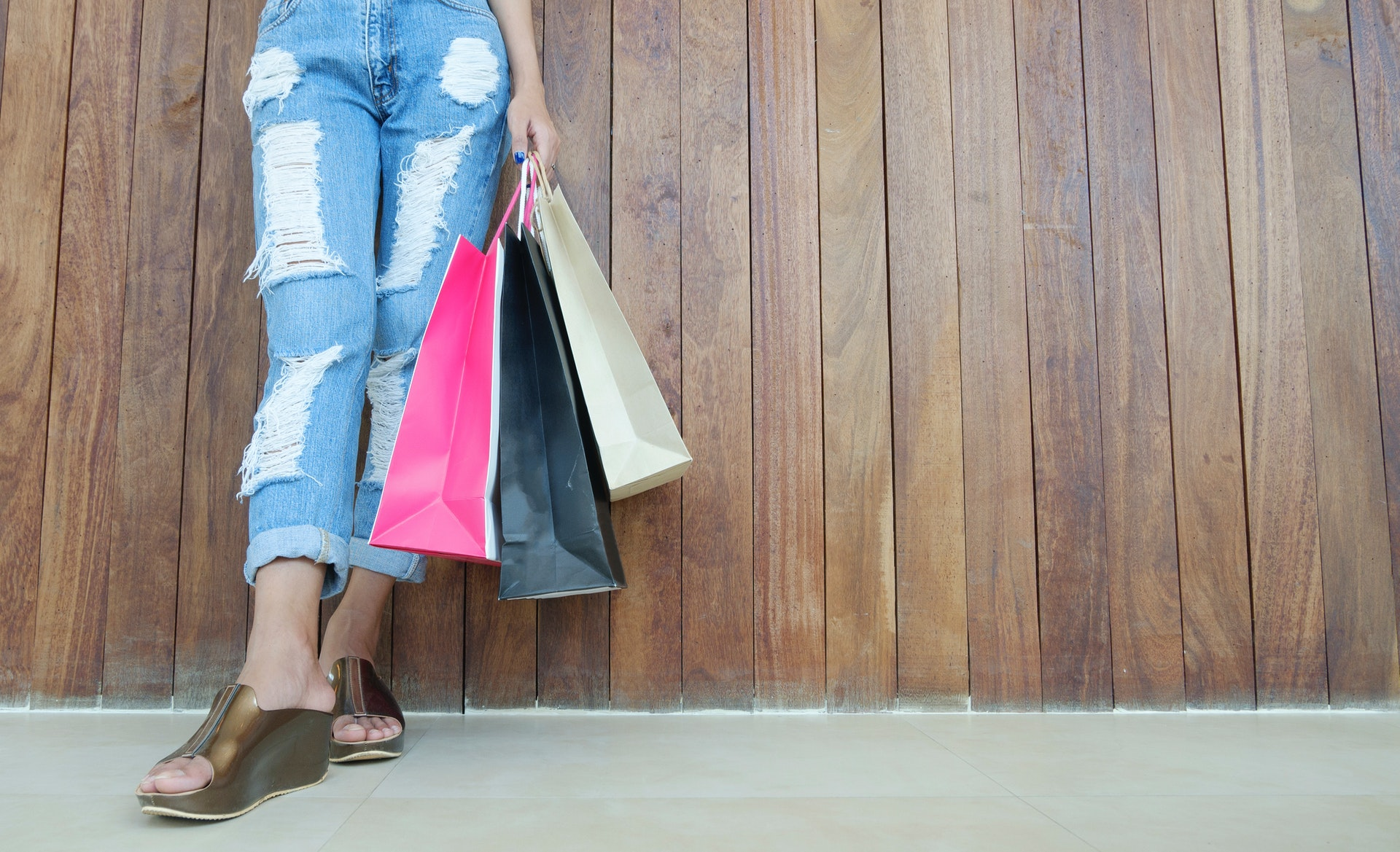 person with shopping bags