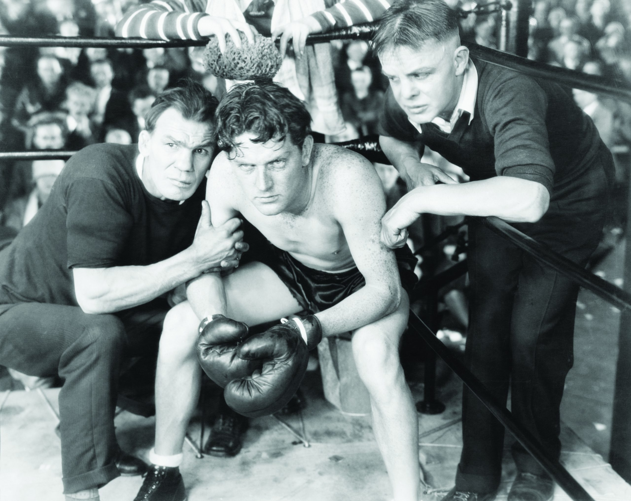Boxer in corner with two coaches